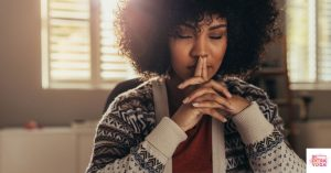 Woman in deep thought. This post discusses the difference between mindfulness and awareness.